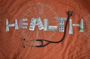 Health spelled out with medication
